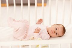 Beautiful infant in crib Stock Photo