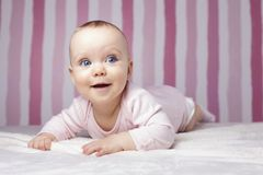 Beautiful infant portrait on colorful background. Stock Photos