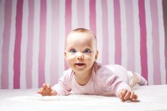 Beautiful infant portrait on colorful background. stock photo