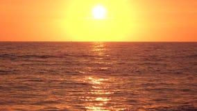 Beautiful infinite sea in the rays sunset touches the horizon. Beautiful infinite shimmering sea in the rays of the bright sunset touches yellow orange the stock video footage