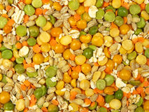 Beautiful ingredients. Colored pieces of beans and cereals abstract background Royalty Free Stock Photo