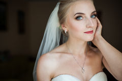 Beautiful innocent blonde bride with blue eyes posing, face clos Royalty Free Stock Images