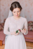 Beautiful innocent bride at home in white wedding dress, preparations concept. Portrait of tender girl in gown Stock Photo