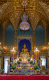 Beautiful inside Thai temple with golden Buddha statue Stock Photos