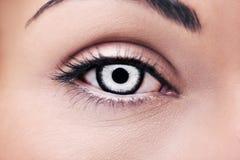 Beautiful insightful look vampires woman`s eye. A beautiful insightful look vampires woman`s eye royalty free stock photo