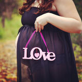 Beautiful instagram of pregnant woman holding quote forest path Stock Photography