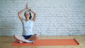 a beautiful intelligent athletic girl does yoga
