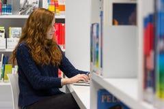Beautiful Intelligent University Girl Using Laptop in White Mode royalty free stock photography