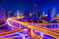 Beautiful interchange overpass and city skyline. Shanghai elevated road junction and interchange overpass at night Stock Images