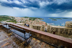 Beautiful and interesting view of old harbor in Hvar town, Croatia after rain. Royalty Free Stock Photo