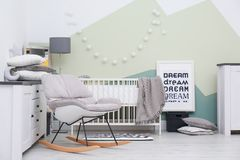 Beautiful interior of baby room with crib. Beautiful interior of baby room with  crib and rocking chair Royalty Free Stock Photography