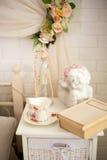 Beautiful interior, book, coffee Cup, angel. Photo zone Stock Photos