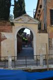 Beautiful Interior Courtyard Seen From Beautiful Small Canal Through An Archway In Venice. Travel, holidays, architecture. March royalty free stock photos