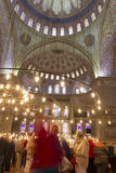 Beautiful Interior of the famous Blue Mosque with visitors Royalty Free Stock Images