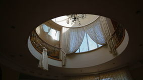 In the beautiful interior hanging wedding dress stock footage