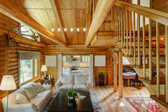 Beautiful interior of a living room. With views of the kitchen and the second floor in a wooden house Stock Photos