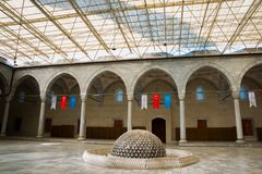 Beautiful interior of the mosque with colorful flags. Kocatepe Mosque. Ankara, Turkey royalty free stock photo