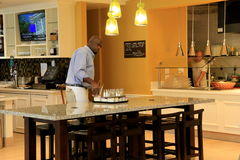 Beautiful interior with workers getting ready for breakfast, buffet area just beyond ,Hilton Garden Inn,Lax,2015 Royalty Free Stock Photos