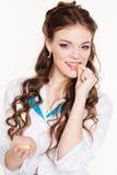 Beautiful intern girl is eating vitamins Stock Photography