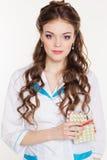 Beautiful intern girl with pills Stock Photo