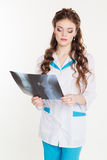 Beautiful intern girl with the x-ray picture Stock Image