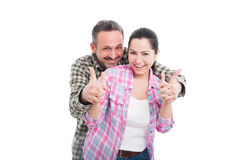 Beautiful intimate couple hug each other. And showing like gesture on white background Royalty Free Stock Images