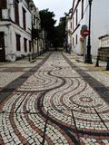 Mosaic Tiled Road in St. Lazarus District of Macau China stock photo