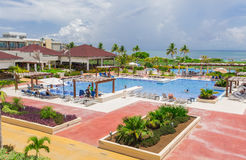 Beautiful inviting view of big, wide open comfortable swimming pool with people relaxing and enjoying their time. Cayo Guillermo island, Iberostar Playa Pilar Royalty Free Stock Images