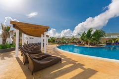 Beautiful inviting view of a curved wide open comfortable swimming pool with people relaxing and enjoying their time. Cayo Guillermo island, Iberostar Playa Royalty Free Stock Images