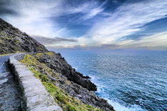 Beautiful ireland. Sunset on the road in Dingle peninsula coastline Stock Images