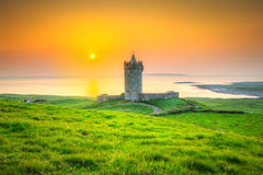 Beautiful irish castle near Atlantic ocean at sunset Stock Photo