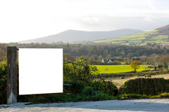 Beautiful irish landscape. And an advertiser board on the farm fence Stock Image