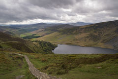 Beautiful Irish landscape with lake Tay in front. Lough Tay is laying peaceful in the sun royalty free stock images