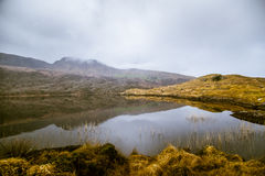 A beautiful irish mountain landscape with a lake in spring. Gleninchaquin park in Ireland royalty free stock images