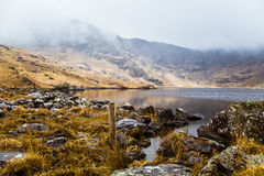 A beautiful irish mountain landscape with a lake in spring. Gleninchaquin park in Ireland royalty free stock photography