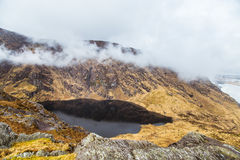 A beautiful irish mountain landscape with a lake in spring. Gleninchaquin park in Ireland stock photography