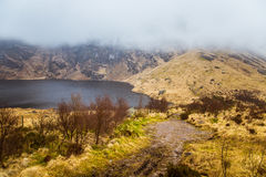 A beautiful irish mountain landscape with a lake in spring. Gleninchaquin park in Ireland stock images
