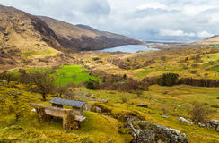 A beautiful irish mountain landscape with a lake in spring. Gleninchaquin park in Ireland royalty free stock photo