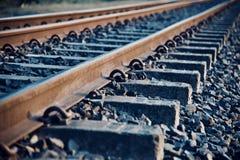 A railway tracks with stones unique photo. Beautiful iron made railway tracks with stones isolated unique photograph stock images
