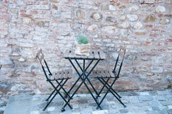 Beautiful iron table for two in an ancient road Stock Photos
