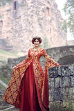 Beautiful Isabella of France, queen of England on Middle Ages period. In red gown near medieval castle Royalty Free Stock Photography