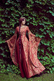 Beautiful Isabella of France, queen of England on Middle Ages period. In red gown near medieval castle royalty free stock images