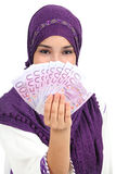 Beautiful islamic woman wearing a hijab showing a lot of banknotes Stock Image