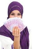 Beautiful islamic woman wearing a hijab showing a lot of banknotes Stock Image