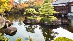 Beautiful island with back-lit pine trees at Koko-en Gardens in Himeji, Japan. Beautiful island at the lake with back-lit pine trees at Koko-en Gardens, a stock photo