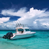 Beautiful island beach with motor boat Royalty Free Stock Photography