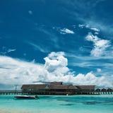 Beautiful island beach with motor boat Royalty Free Stock Photo