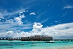 Beautiful island beach with motor boat Royalty Free Stock Photos