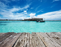 Beautiful island beach with motor boat Royalty Free Stock Image