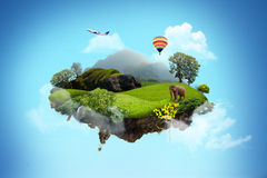 Beautiful island floating on sky. Beautiful island is floating on blue sky. There are forest, green field, elephant and big tree on land. And there are colorful royalty free stock photography